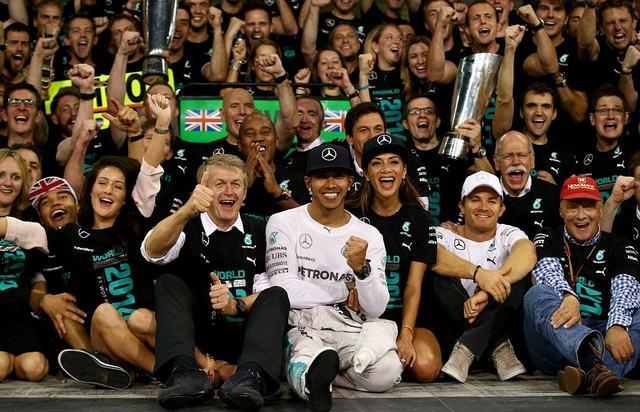 Hamilton and Scherzinger sit after the driver won the World Championship